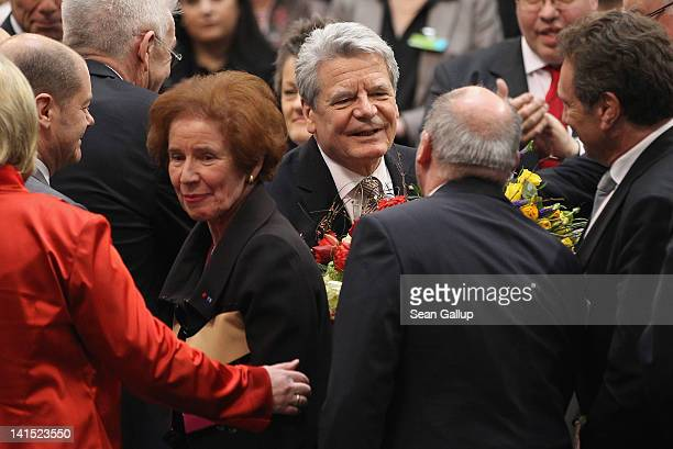 Joachim Gauck Lutheran pastor and former East German humanrights activist is congratulated by leading members of Die Linke leftwing politicial party...