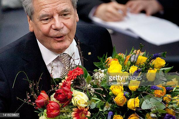 Joachim Gauck Lutheran pastor and former East German humanrights activist is congratulated by members of the Bundestag after Gauck was elected new...