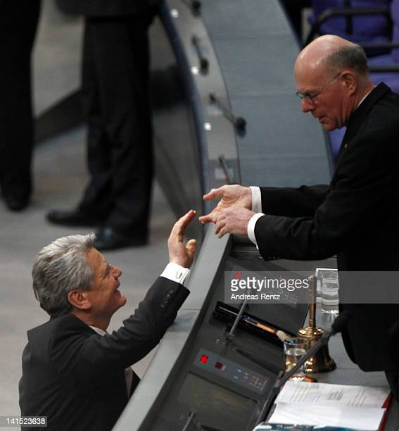 Joachim Gauck Lutheran pastor and former East German humanrights activist rises to speak at the Bundestag gets gratulation of President of the...