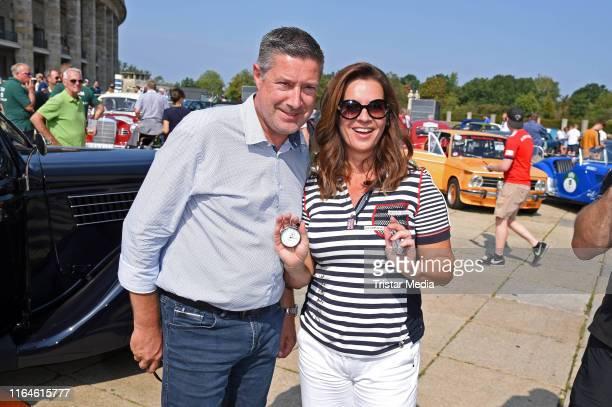 Joachim Llambi and Katarina Witt attend the Start of the Auto Bild Klassik HamburgBerlin Rallye at Olympiastadion on August 29 2019 in Berlin Germany