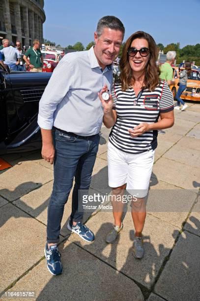 Joachim Llambi and Katarina Witt attend the Start of the Auto Bild Klassik Hamburg-Berlin Rallye at Olympiastadion on August 29, 2019 in Berlin,...