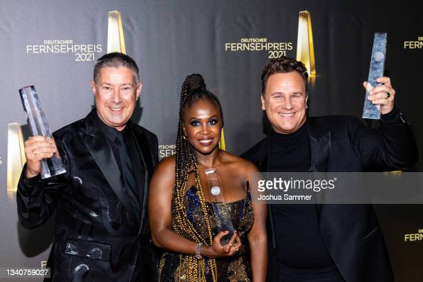 "Joachim Llambi, Motsi Mabuse and Guido Maria Kretschmer pose with the ""Bestes Factual Entertainment"" award during the German Television Award at..."