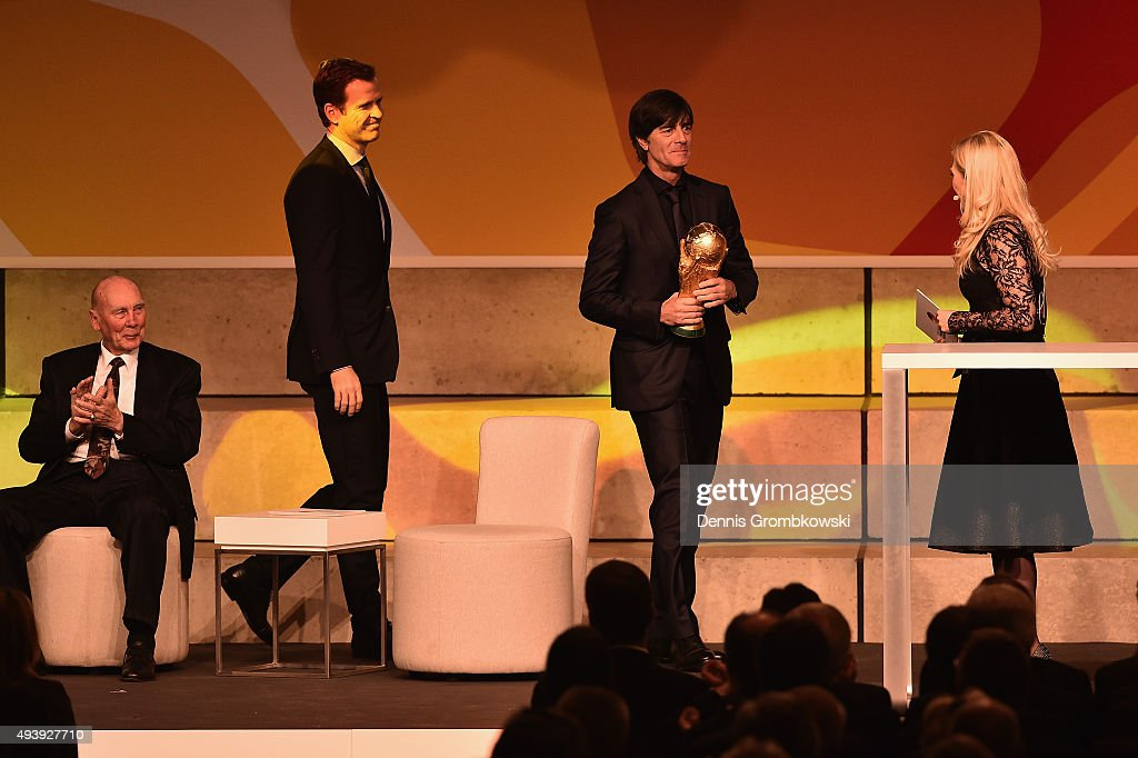 Joachim Loew and Oliver Bierhoff bring the FIFA 2014 World Cup trophy during the Opening Gala of the German Football Museum on October 23, 2015 in Dortmund, Germany.