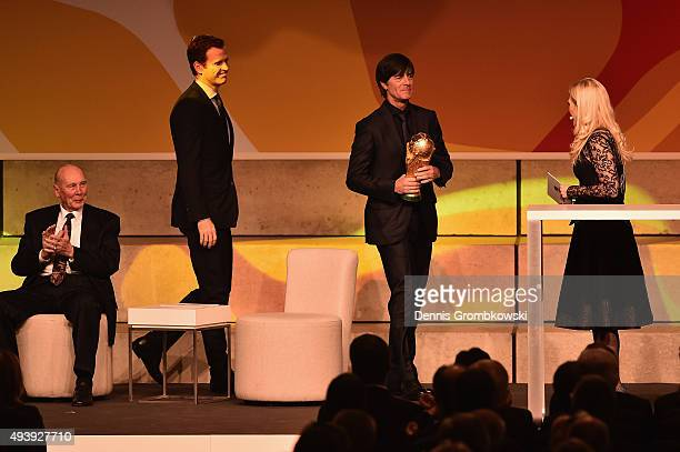 Joachim Loew and Oliver Bierhoff bring the FIFA 2014 World Cup trophy during the Opening Gala of the German Football Museum on October 23, 2015 in...
