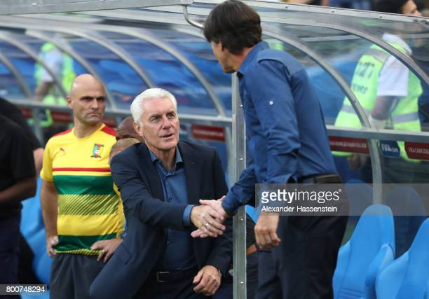 Joachim Loew coach of Germany and Hugo Broos head coach of of Cameroon shake hands prior to the FIFA Confederations Cup Russia 2017 Group B match...