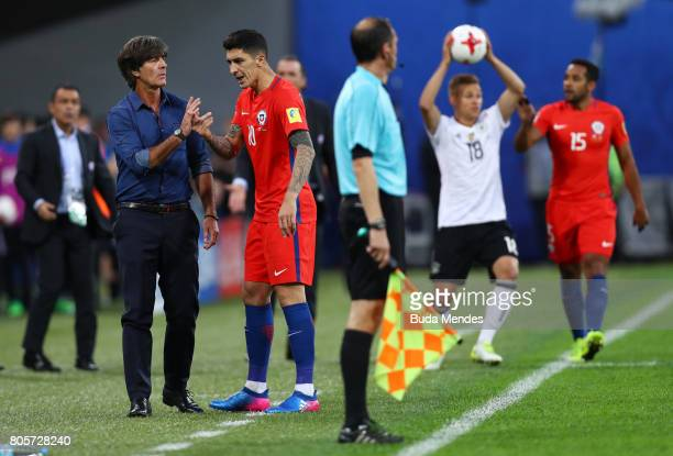 Joachim Loew coach of Germany and Pablo Hernandez of Chile argue during the FIFA Confederations Cup Russia 2017 Final between Chile and Germany at...