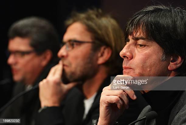 Joachim Loew head coach of German National Team looks thoughtful next to Juergen Klopp head coach of Borussia Dortmund and Herbert Fandel head of the...