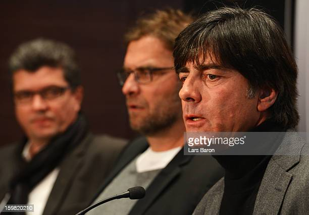 Joachim Loew head coach of German National Team speaks next to Juergen Klopp head coach of Borussia Dortmund and Herbert Fandel head of the DFB...