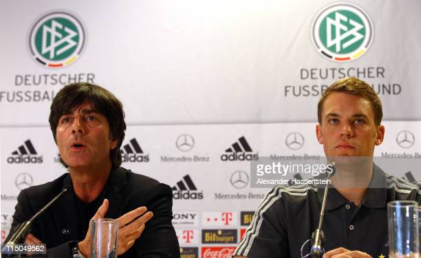 Joachim Loew , head coach of Germany attends with his keeper Manuel Neuer a press conference ahead of their UEFA EURO 2012 qualifying match against...