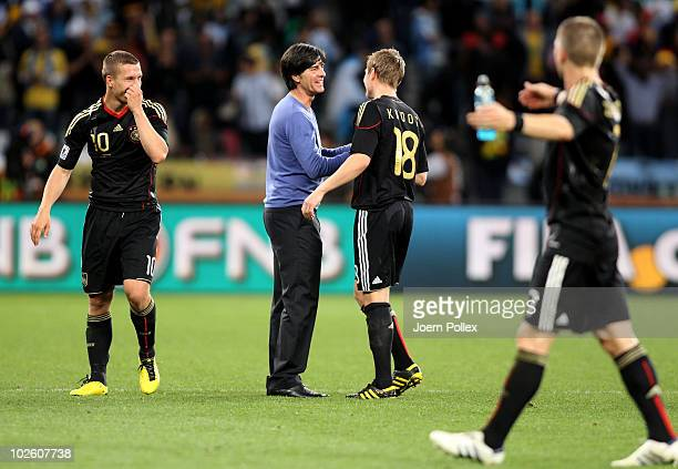 Joachim Loew head coach of Germany celebrates victory with Toni Kroos during the 2010 FIFA World Cup South Africa Quarter Final match between...