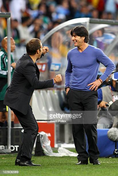 Joachim Loew head coach of Germany celebrates with Hans Dieter Flick assistant coach of Germany during the 2010 FIFA World Cup South Africa Quarter...