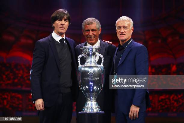 Joachim Loew, Head Coach of Germany, Fernando Santos, Head Coach of Portugal, and Didier Deschamps, Head Coach of France, pose for a photo with The...