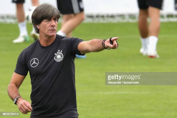 Joachim Loew head coach of Germany gives intsructions to his players during a training session of the German national team at Sportanlage Rungg on...