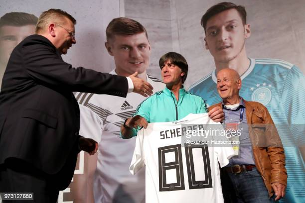 Joachim Loew head coach of Germany handover a Germany match jersey with Reinhard Grindel President of the German National Football Federation to...