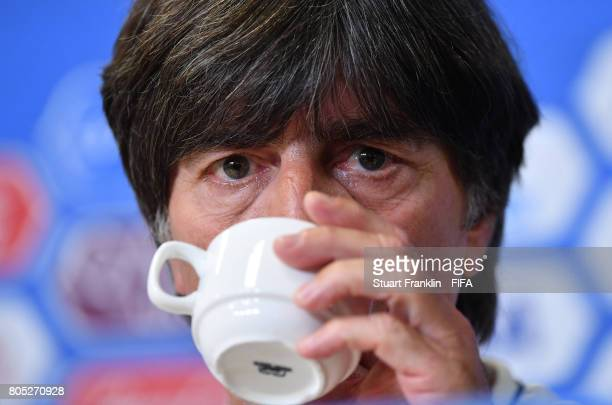 Joachim Loew head coach of Germany has a drink of tea during a press conference of the German national football team on July 1 2017 in Saint...