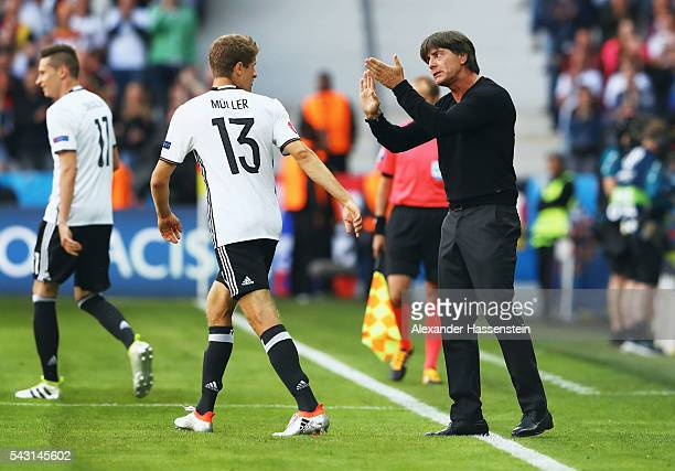 Joachim Loew head coach of Germany instructs Thomas Mueller after their team's first goal during the UEFA EURO 2016 round of 16 match between Germany...