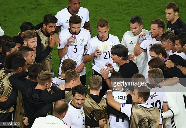 Joachim Loew head coach of Germany instructs while players listen with forming a huddle before the extra time during the UEFA EURO 2016 quarter final...