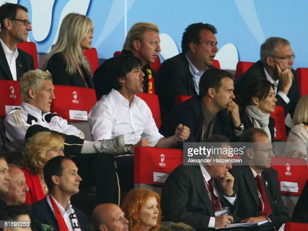 Joachim Loew , head coach of Germany is seen on the tribune next to Bastian Schweinsteiger after been sent off due to an arguement with Josef...