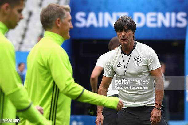 Joachim Loew head coach of Germany looks on during a team Germany training session ahead of the UEFA EURO 2016 Group C match between Germany and...