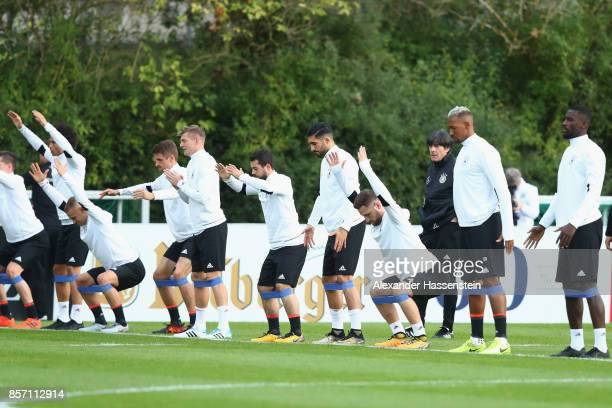 Joachim Loew head coach of Germany looks on during a team Germany training session at Kleine Kampfbahn Stadium on October 3 2017 in Frankfurt am Main...