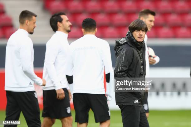 Joachim Loew head coach of Germany looks on during a training session at Opel Arena Mainz ahead of their FIFA 2018 World Cup Group C against...