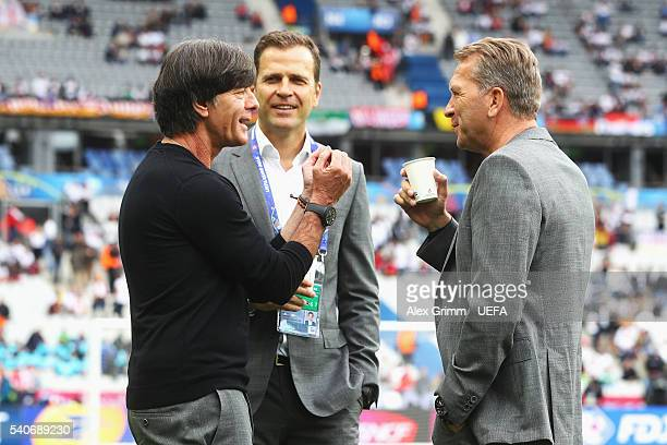 Joachim Loew head coach of Germany Oliver Bierhoff manager of Germany and Andreas Koepke goalkeeping coach of Germany talk prior to the UEFA EURO...