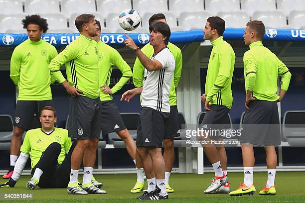Joachim Loew head coach of Germany plays with the ball during a team Germany training session ahead of the UEFA EURO 2016 Group C match between...