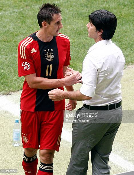 Joachim Loew head coach of Germany speakes to Miroslav Klose during the international friendly match between Germany and Belarus at the FritzWalter...