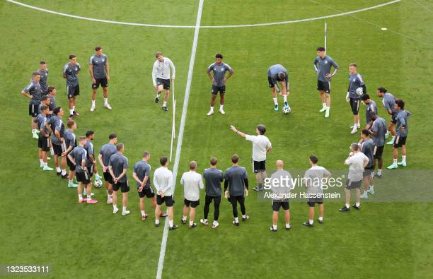 Joachim Loew, Head Coach of Germany speaks to his players during the Germany Training Session ahead of the Euro 2020 Group F match between France and...