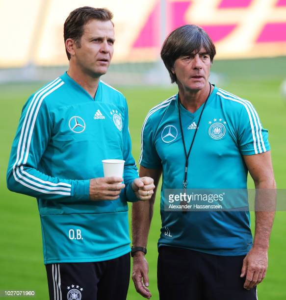 Joachim Loew head coach of Germany speaks to Oliver Bierhoff Manager of Germany during team training before the International Friendly football match...