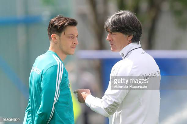 Joachim Loew head coach of Germany talks to his palyer Mesut Oezil during the Germany training session ahead of the 2018 FIFA World Cup at CSKA...