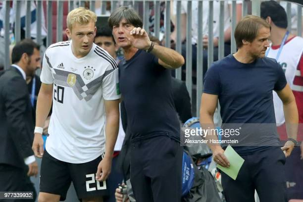 Joachim Loew head coach of Germany talks to his player Julian Brandt during the 2018 FIFA World Cup Russia group F match between Germany and Mexico...