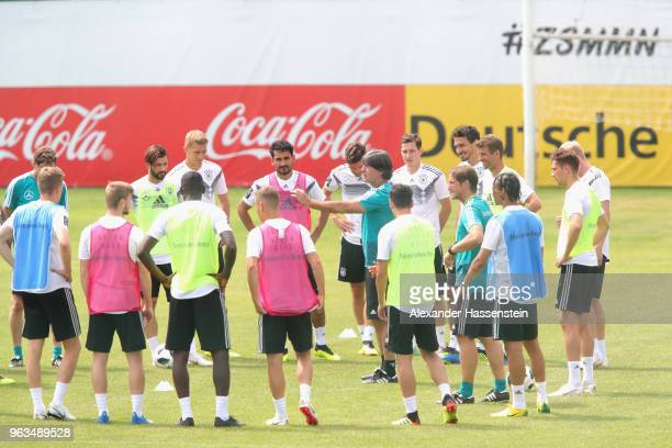 Joachim Loew, head coach of Germany talks to his players during a training session of the German national team at Sportanlage Rungg on day seven of...