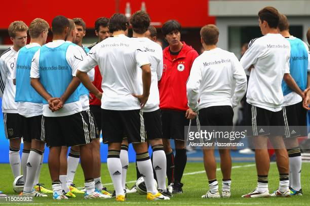 Joachim Loew, head coach of Germany talks to his players during a training session ahead of their UEFA EURO 2012 qualifying match against Austria on...