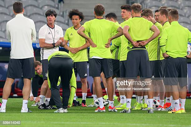 Joachim Loew head coach of Germany talks to his players during a Germany training session at Stade PierreMauray ahead of their opening UEFA EURO 2016...