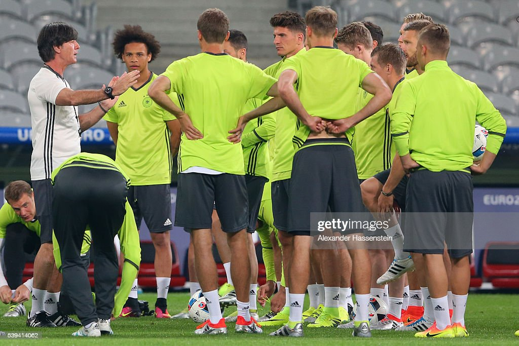 Joachim Loew, head coach of Germany talks to his players during a Germany training session at Stade Pierre-Mauray ahead of their opening UEFA EURO 2016 match against Ukraine, on June 12, 2016 in Lille, France.