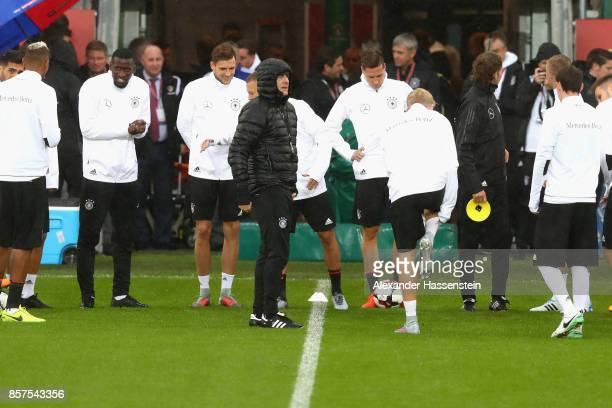 Joachim Loew head coach of Germany talks to his players during a team Germany training session at Windsor Park ahead of their FIFA 2018 World Cup...