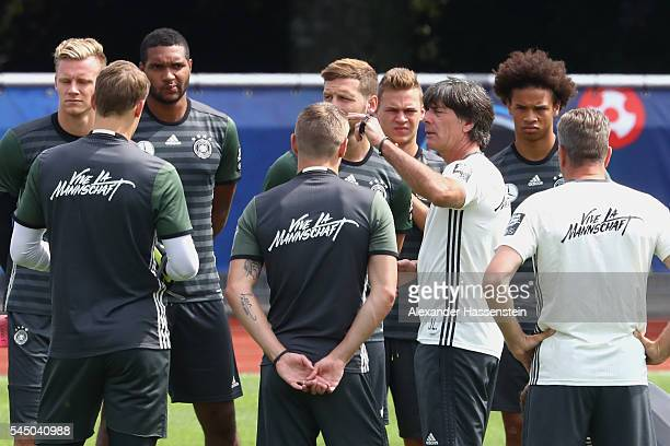 Joachim Loew head coach of Germany talks to his players prior to a Germany training session at Ermitage Evian on July 05 2016 in EvianlesBains France