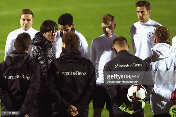 Joachim Loew head coach of Germany talks to his players prior to a training session of the German national team at Stadio di Santamonica di Misano...