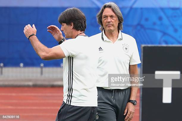 Joachim Loew head coach of Germany talks to team doctor HansWilhelm MuellerWohlfahrt during a Germany training session ahead of their Euro 2016 round...