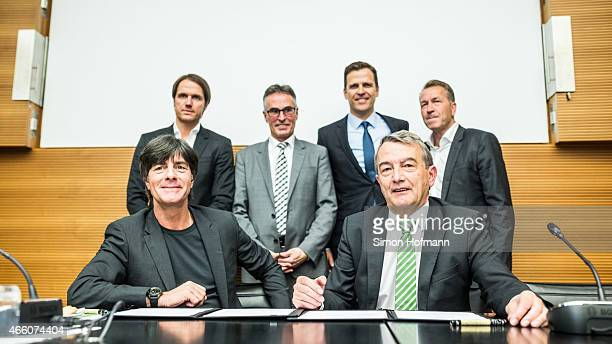 Joachim Loew head coach of the German national football team and DFB President Wolfgang Niersbach pose with Thomas Schneider Helmut Sandrock Oliver...