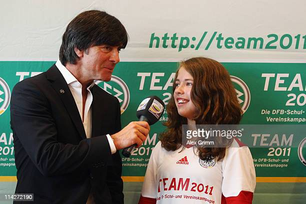 Joachim Loew head coach of the German national football team listens to a question by 12yearold Johanna of TuS Felde during a DFB campaign 'TEAM...