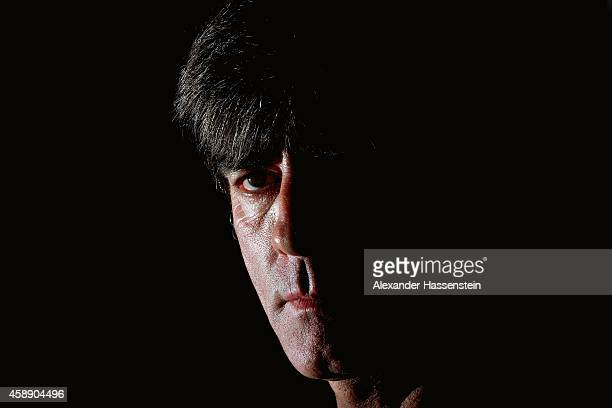 Joachim Loew head coach of the German national football team looks on during a press conference ahead of their UEFA EURO 2016 qualifying match...