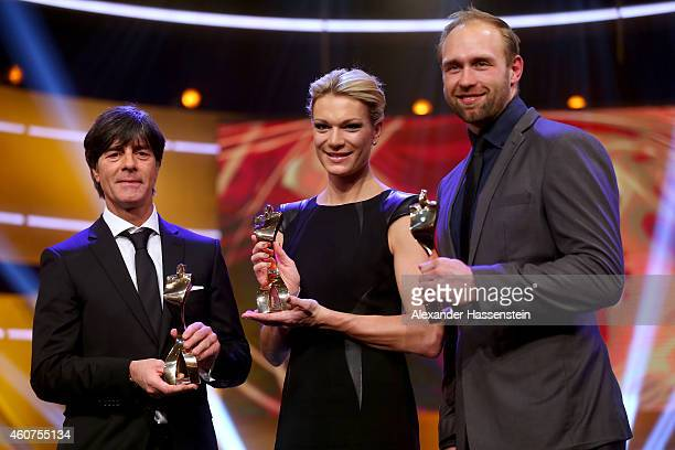 Joachim Loew, head coach of the German national football team, Maria Hoefl-Riesch and Robert Harting pose with their Athlete of the Year awards after...