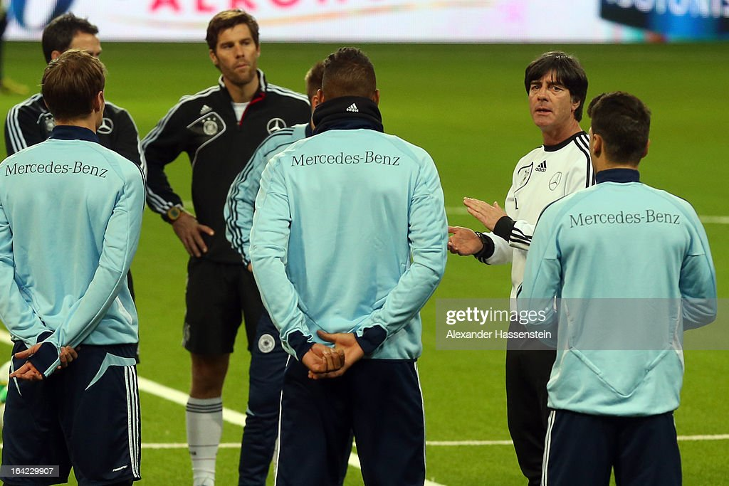 Joachim Loew, head coach of the German national football team talks to his players during a training session at Astana arena on March 21, 2013 in Astana, Kazakhstan.