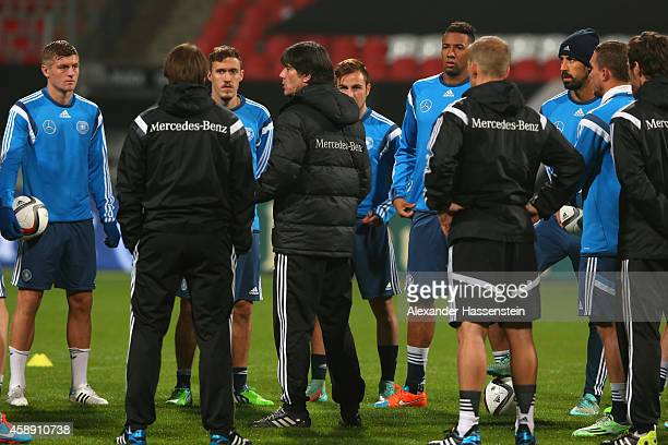 Joachim Loew head coach of the German national football team talks to his players prior to a training session ahead of their UEFA EURO 2016...