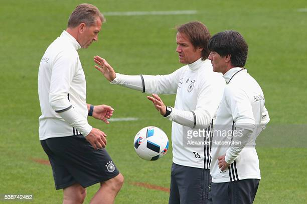 Joachim Loew head coach of the German national team and his assistant coaches Thomas Schneider and Andreas Koepcke seen during a Germany training...