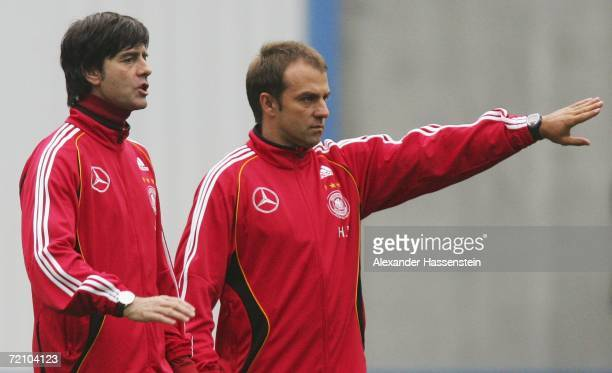 Joachim Loew head coach of the German National Team and his assistant coach HansDieter Flick gives instructions during the training session of the...