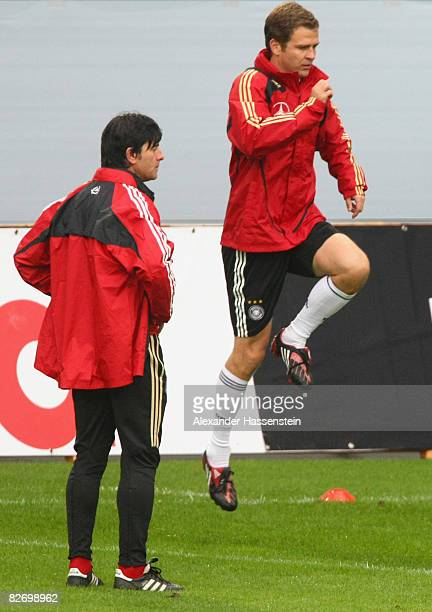 Joachim Loew head coach of the German National team and Oliver Bierhoff manager of the German National team seen during a training session of the...