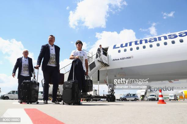 Joachim Loew , head coach of the German national team arrives with Reinhard Grindel , president of the German Football Association and Reinhard...